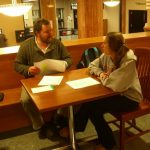 Instructor and student talking at Memorial Library satellite